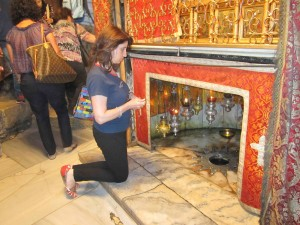 Irene praying at the site of Jesus' birth in Bethlehem